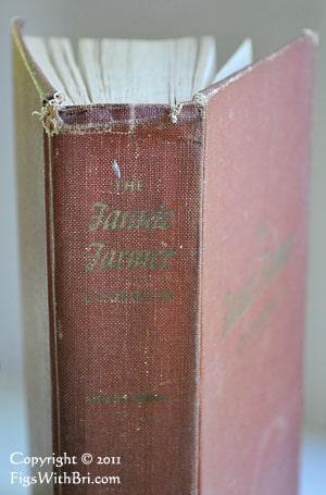 worn spine of old fannie farmer hardbound cookbook