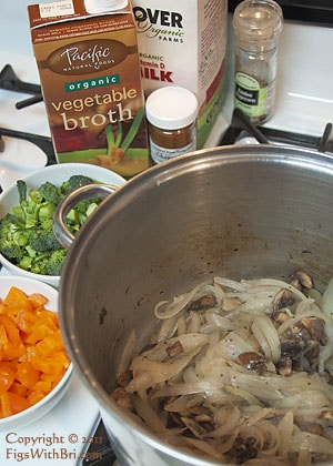 soup makings: sauteed onion and mushrooms in a pot, other ingredients nearby