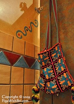 bright huichol bag hanging on a door hook