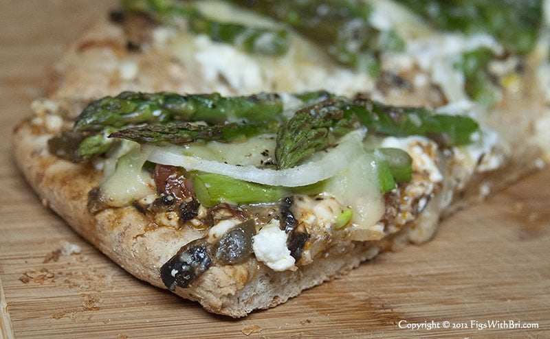 yummy slice of hot asparagus pizza