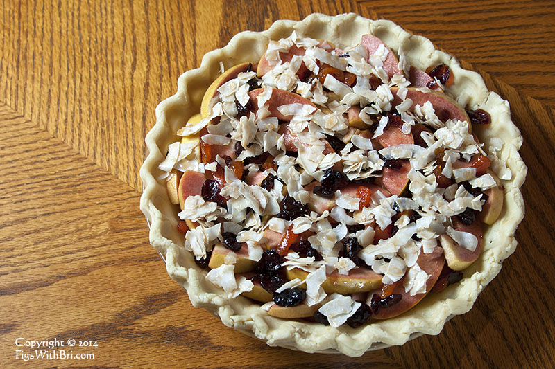 hidden rose apple cranberry apricot pie ready to bake